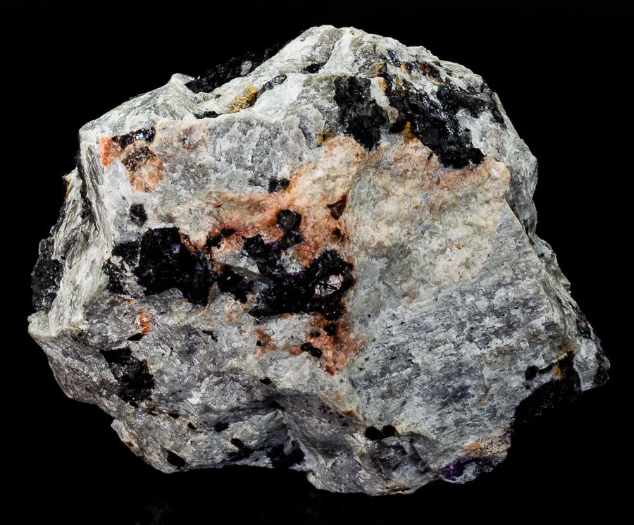 Zircon Molybdenite Ferrokentbrooksite Aegirine & Feldspar