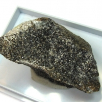 Ganomalite