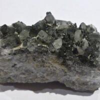 Tochilinite Calcite Magnetite & Pyrite