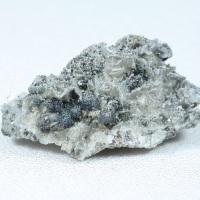 Pääkkönenite & Calcite
