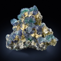 Fluorite With Herderite On Muscovite
