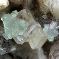Fluorite & Chalcopyrite On Calcite With Hematite Inclusions