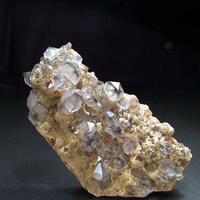 Hematite Inclusions In Amethyst On Rhodochrosite