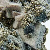 Pyrargyrite & Pyrite On Manganoan Calcite