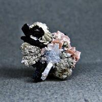 Bastnäsite-(Ce) & Rhodochrosite & Natrolite & Astrophyllite
