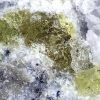 Hydroxylellestadite
