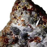 Magnetite Fluoborite Chondrodite & Calcite