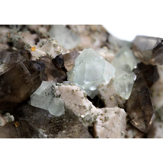 Fluorite On Orthoclase With Smoky Quartz & Spessartine