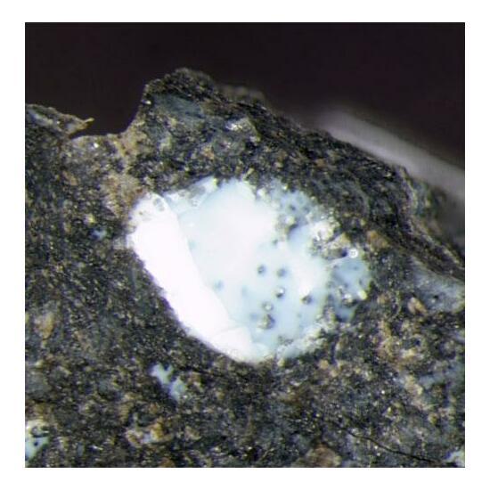 Tacharanite